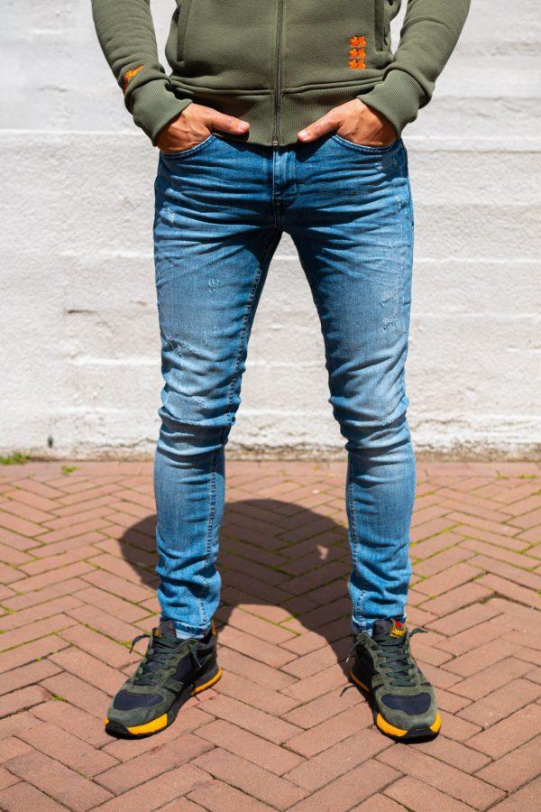 Stretch jeans kapotte stukjes