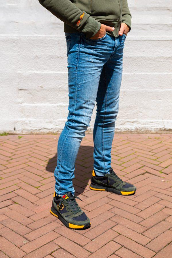 stretch jeans kapot zijkant